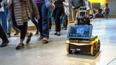 New Robot Rolls with the Rules of Pedestrian Conduct